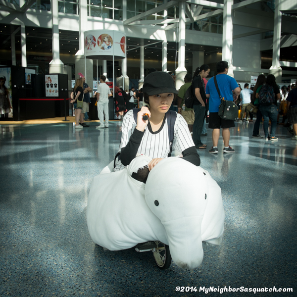 This might be the only photo of her on her tricycle. Right before this picture, 'the 'man' said she couldn't ride around AX on tricycle. Personally, I thought it was pretty cool cosplay.